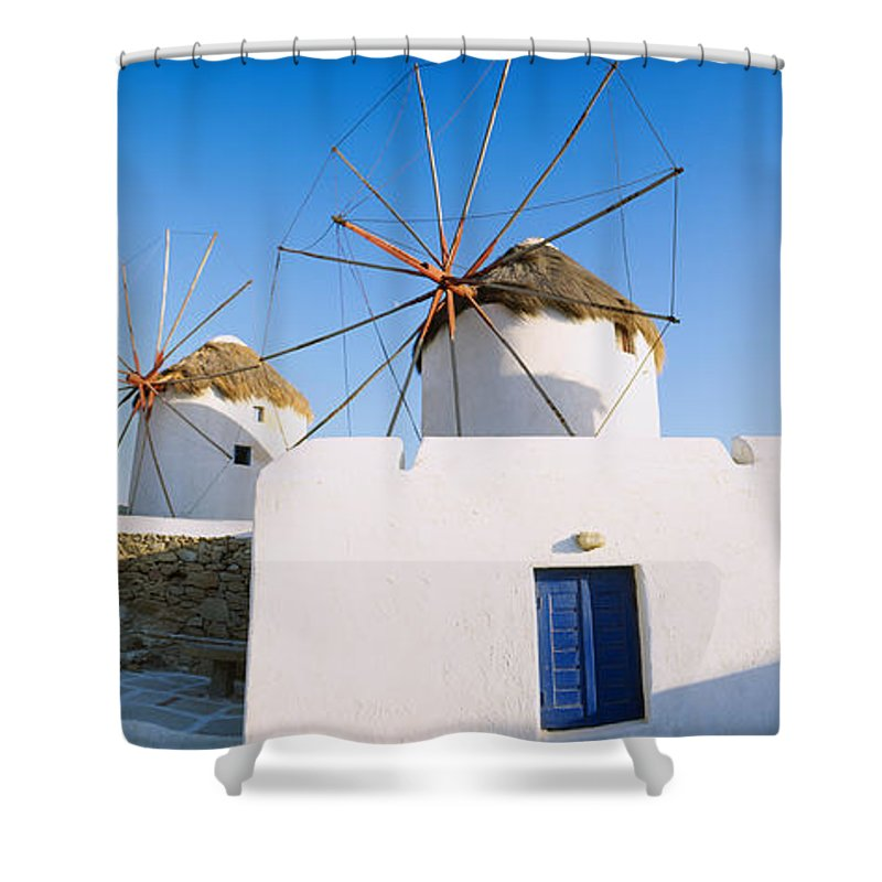 Photography Shower Curtain featuring the photograph Traditional Windmill In A Village by Panoramic Images