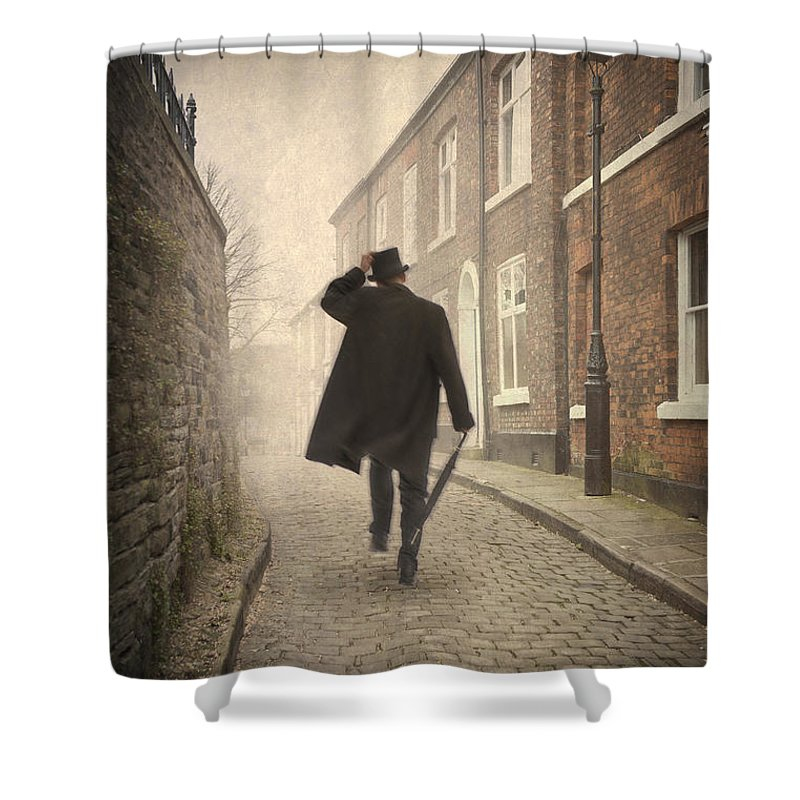 Victorian Shower Curtain featuring the photograph Victorian Man Running On A Cobbled Road by Lee Avison