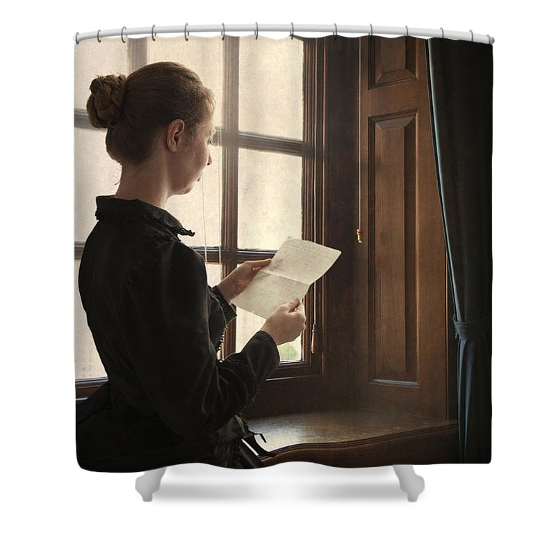 Woman Shower Curtain featuring the photograph Victorian Or Edwardian Woman Reading A Letter By The Window by Lee Avison