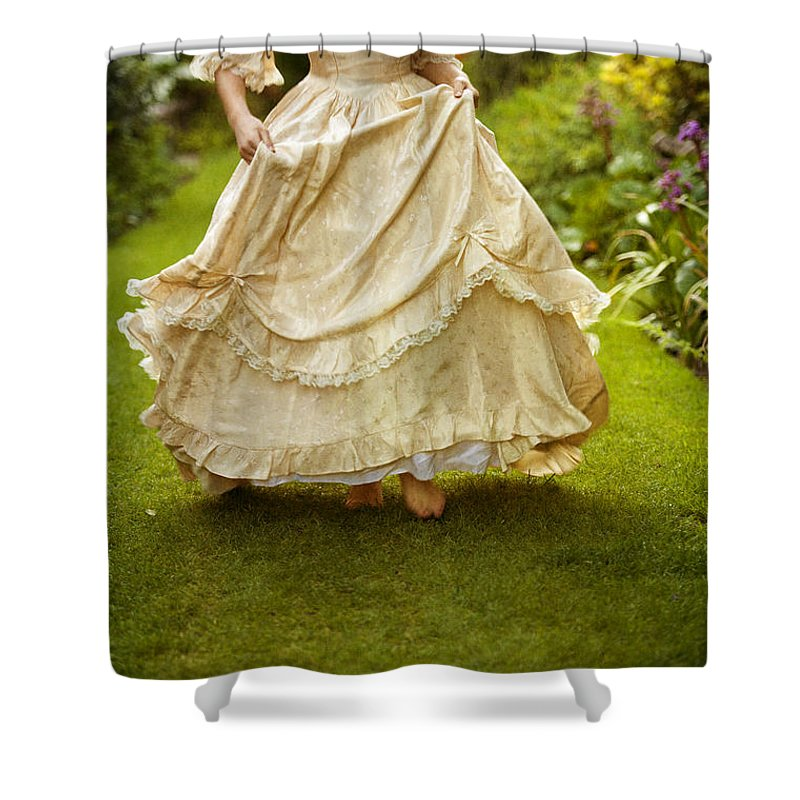 Woman Shower Curtain Featuring The Photograph Victorian Woman Running On A  Summer Lawn By Lee Avison