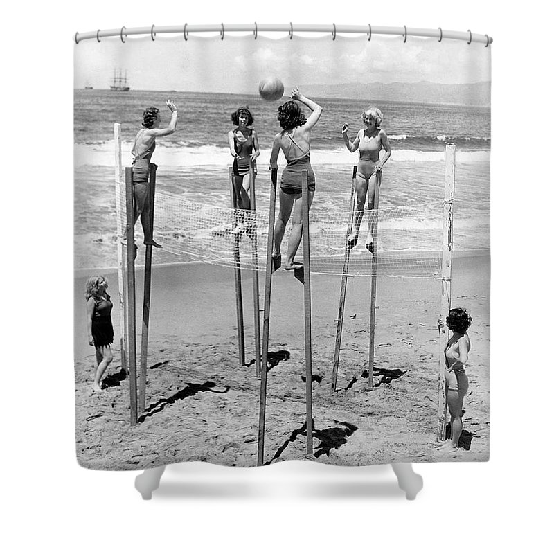 1930's Shower Curtain featuring the photograph Volleyball On Stilts by Underwood Archives