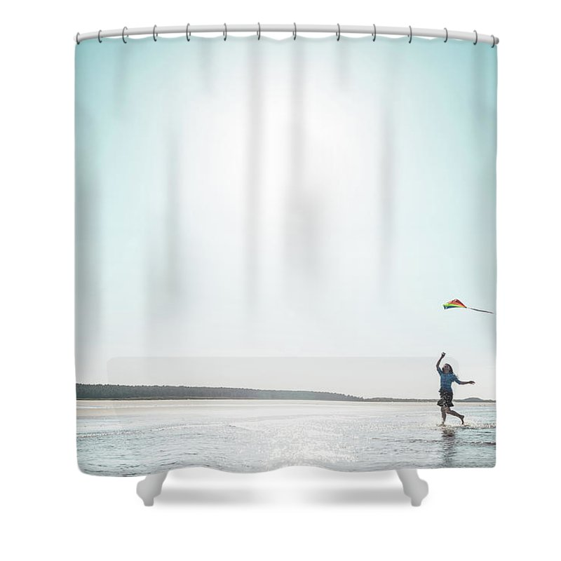Three Quarter Length Shower Curtain featuring the photograph Woman Flying Kite On Beach by Dan Brownsword