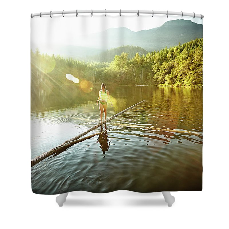 Pets Shower Curtain featuring the photograph Woman Walking On Log In Alpine Lake by Thomas Barwick