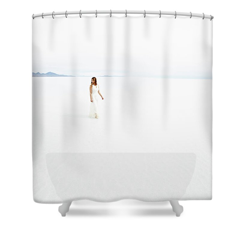Scenics Shower Curtain featuring the photograph Woman Wearing Dress Walking Through by Thomas Barwick