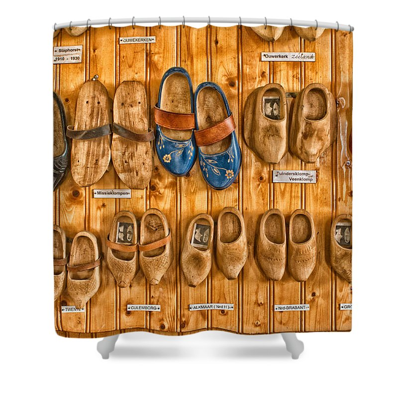 Wooden Shoes Shower Curtain featuring the photograph Wooden Shoes by Brothers Beerens