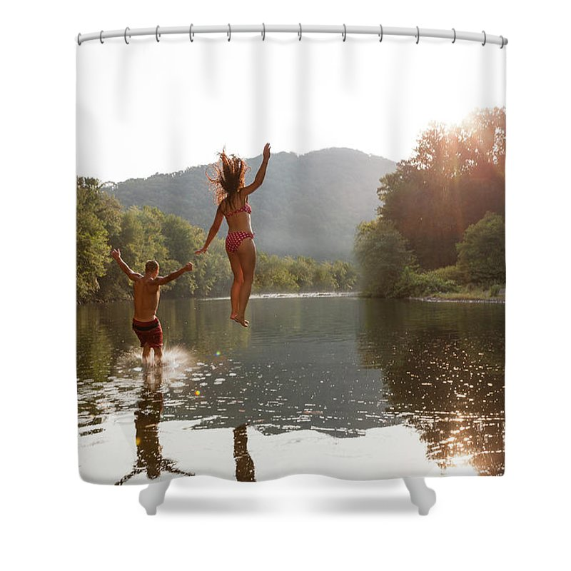 Young Men Shower Curtain featuring the photograph Young Couple Jumping Into River by Zave Smith