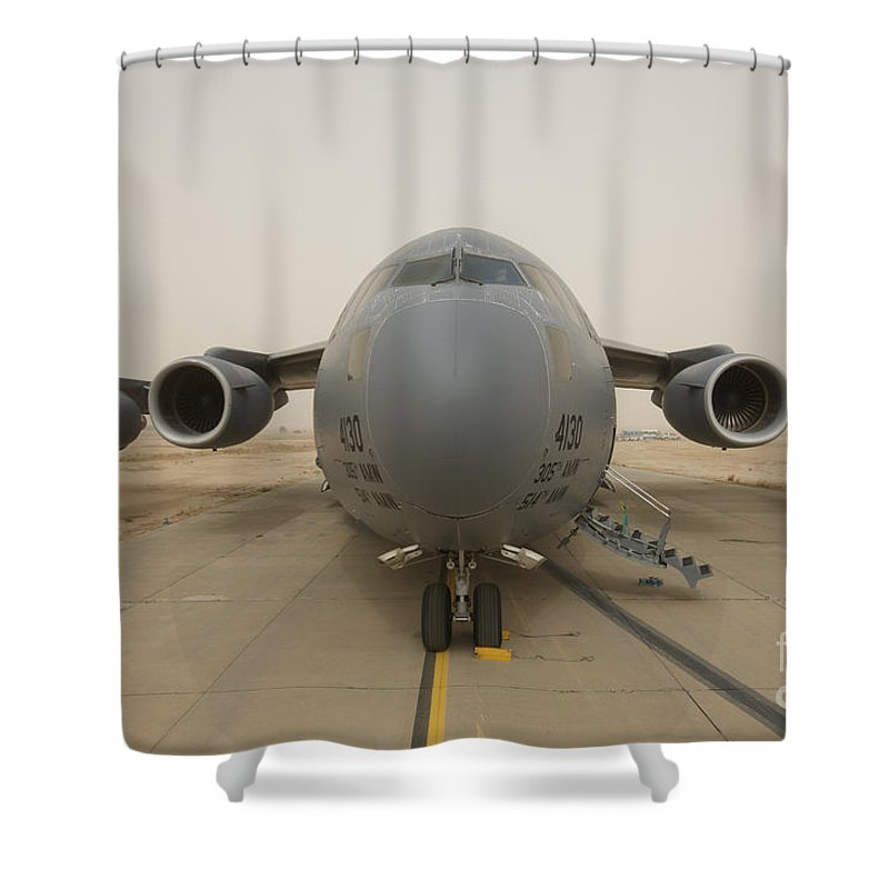 Aviation Shower Curtain featuring the photograph A C-17 Globemaster IIi Sits by Terry Moore