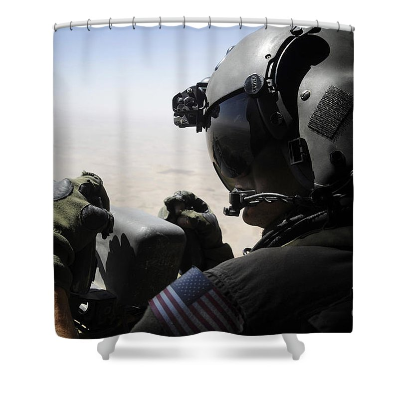 Aerial Gunner Shower Curtain featuring the photograph A Soldier Provides Security by Stocktrek Images