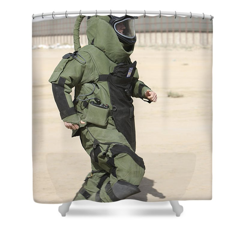 Explosive Ordnance Disposal Shower Curtain featuring the photograph A U.s. Marine Tries Running In A Bomb by Terry Moore