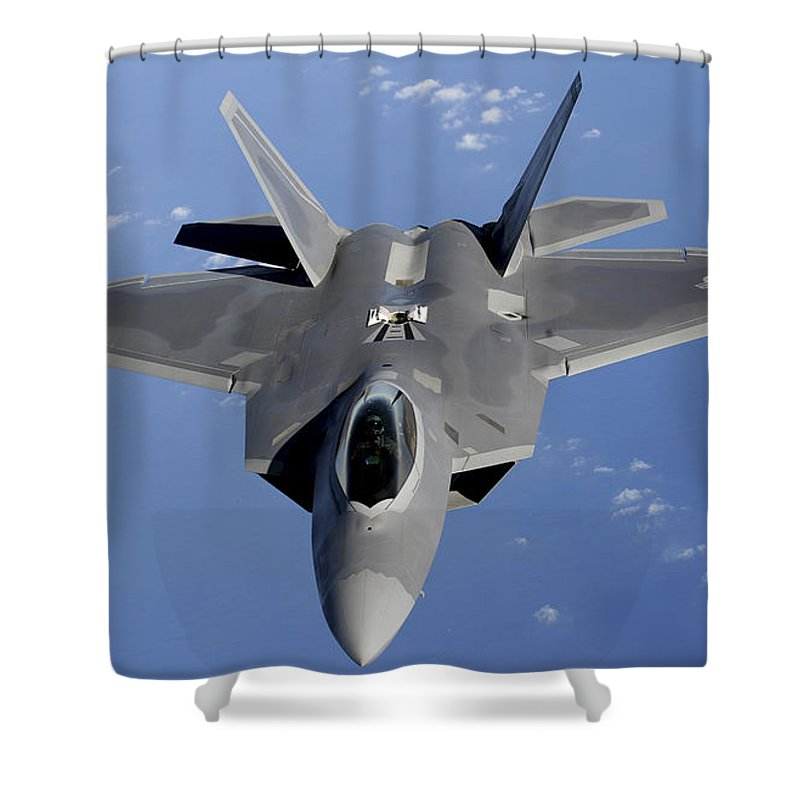 F-22 Raptor Shower Curtain featuring the photograph An F-22 Raptor Moves Into Position by Stocktrek Images