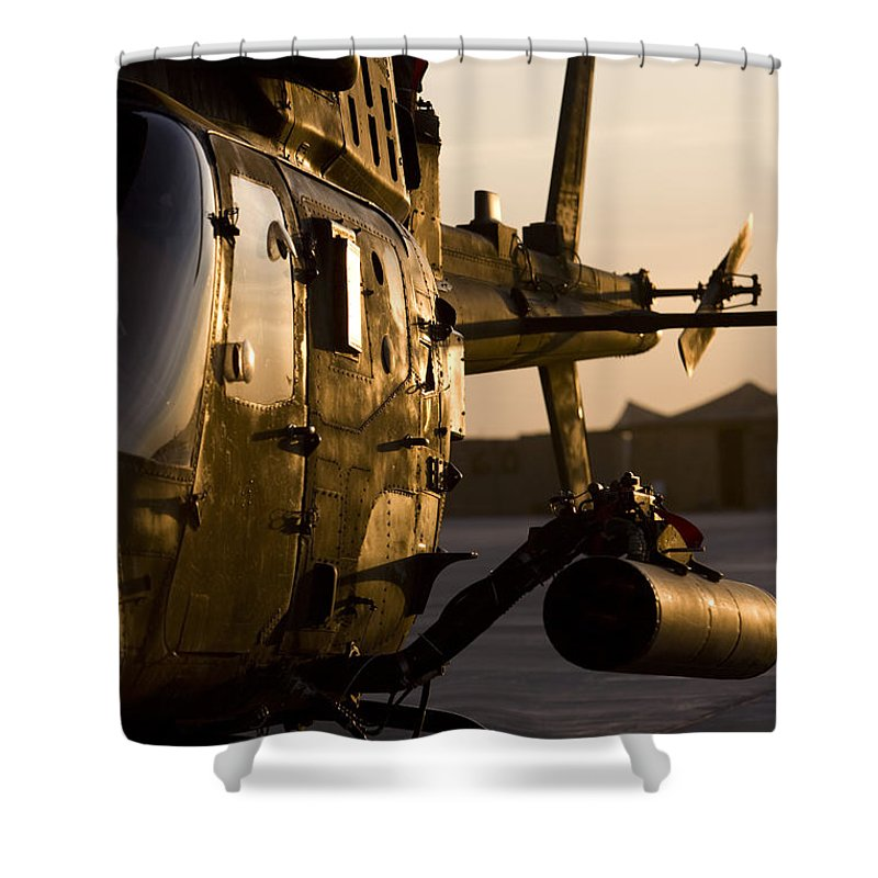 Aviation Shower Curtain featuring the photograph An Oh-58d Kiowa During Sunset by Terry Moore