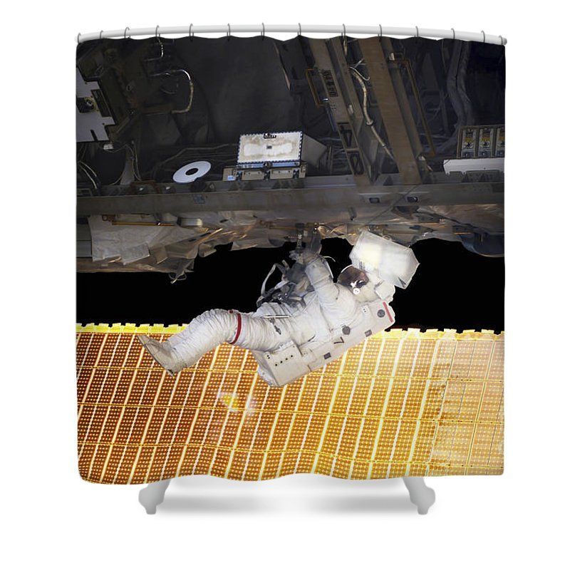 Adults Only Shower Curtain featuring the photograph Astronaut Participates In A Spacewalk by Stocktrek Images