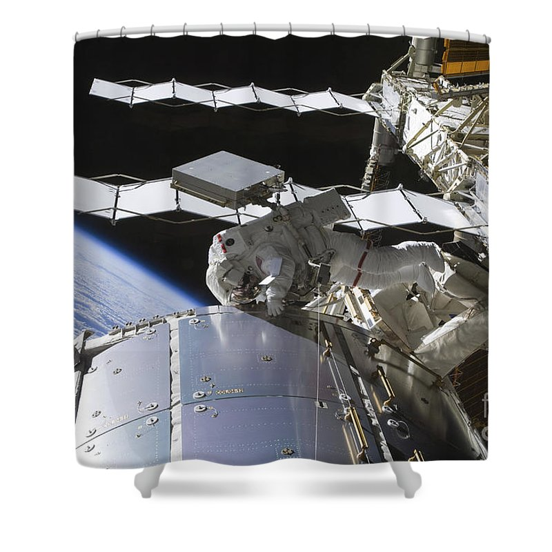 Sts-128 Shower Curtain featuring the photograph Astronaut Working On The International by Stocktrek Images
