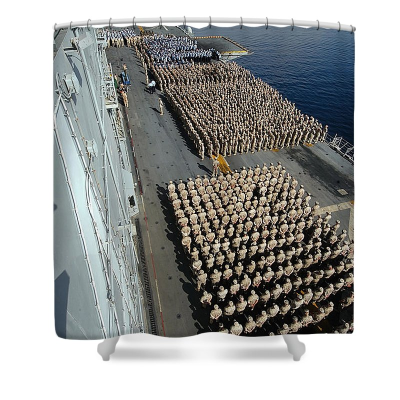 Color Image Shower Curtain featuring the photograph Crew Aboard The Amphibious Assault Ship by Stocktrek Images