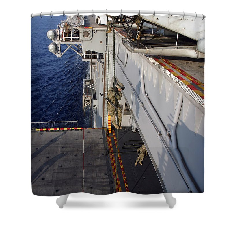 Aircraft Shower Curtain featuring the photograph Marines And Sailors Fast-rope by Stocktrek Images