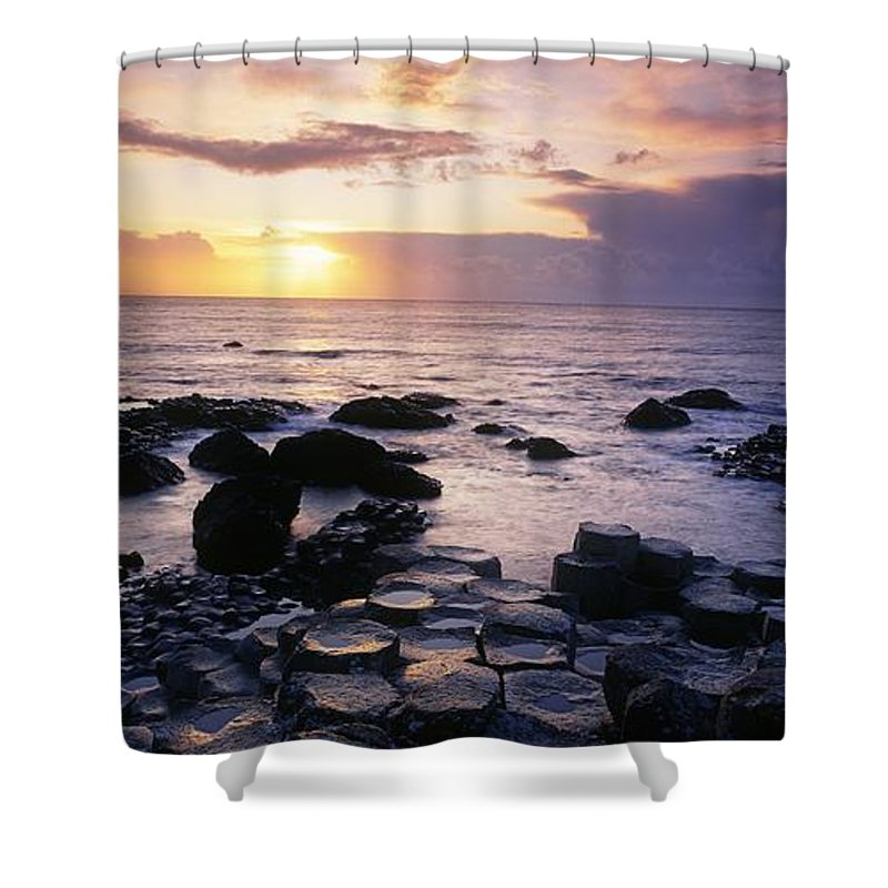 Basalt Shower Curtain featuring the photograph Rocks On The Beach, Giants Causeway by The Irish Image Collection