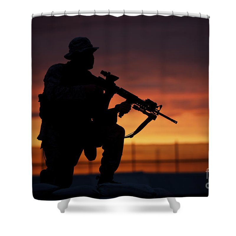 Marine Shower Curtain featuring the photograph Silhouette Of A U.s Marine On A Bunker by Terry Moore