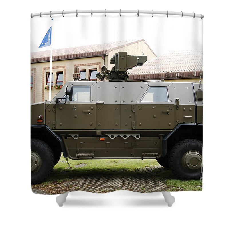Armament Shower Curtain featuring the photograph The Multi-purpose Protected Vehicle by Luc De Jaeger