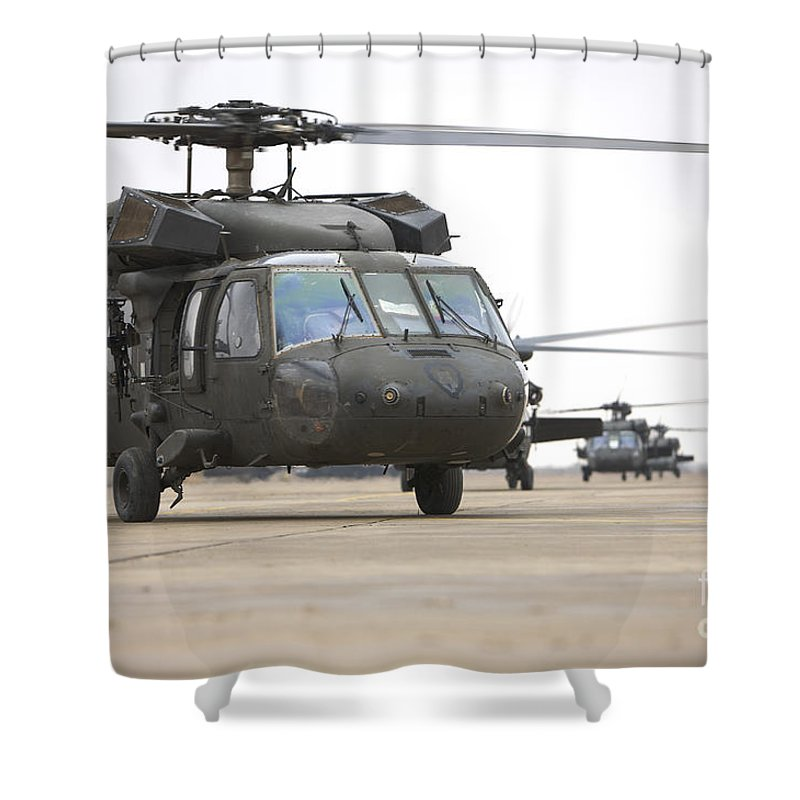 Aviation Shower Curtain featuring the photograph Uh-60 Black Hawks Taxis by Terry Moore