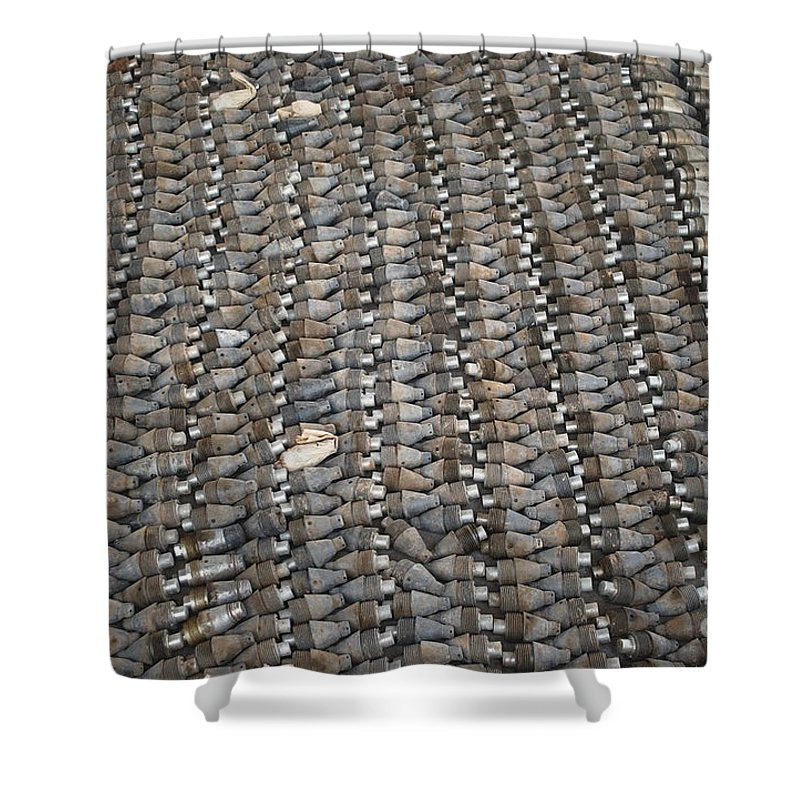 Horizontal Shower Curtain featuring the photograph Unexploded Ordnance Lies In Storage by Stocktrek Images
