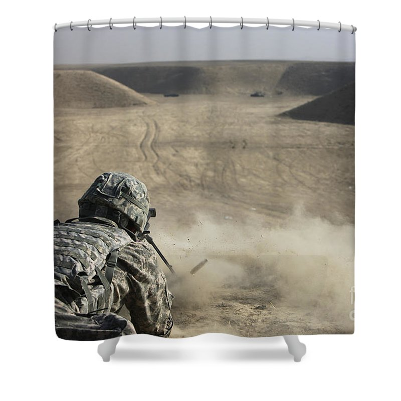 Operation Enduring Freedom Shower Curtain featuring the photograph U.s. Army Soldier Fires A Barrett M82a1 by Terry Moore