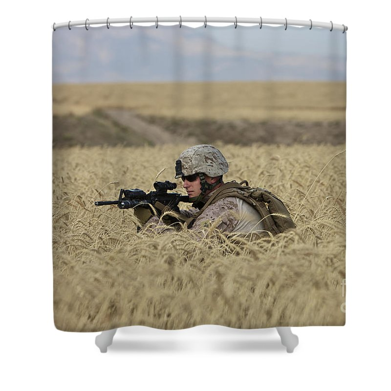 Field Shower Curtain featuring the photograph U.s. Marine Patrols A Wadi Near Kunduz by Terry Moore