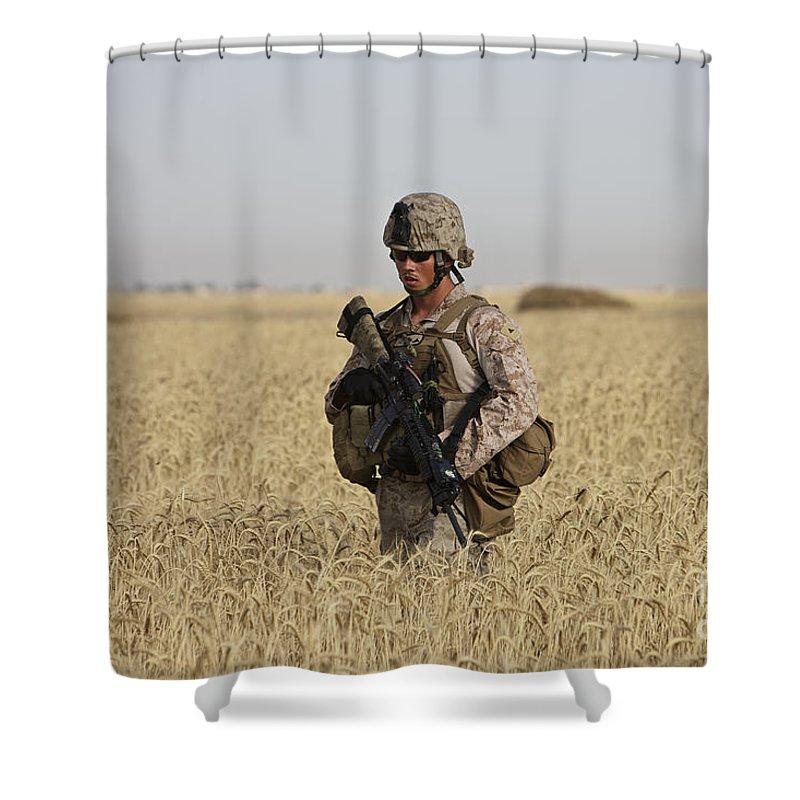 Wheat Shower Curtain featuring the photograph U.s. Marine Patrols A Wadi Near Kunduz by Terry Moore