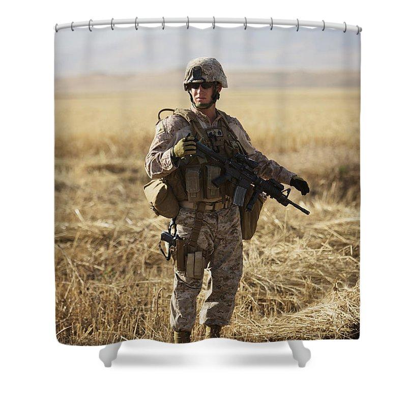 Field Shower Curtain featuring the photograph U.s. Marine Patrols A Wadi Near Kunduz by Terry Moore