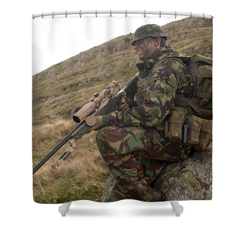 Foreign Military Shower Curtain featuring the photograph A British Soldier Armed With A Sniper by Andrew Chittock