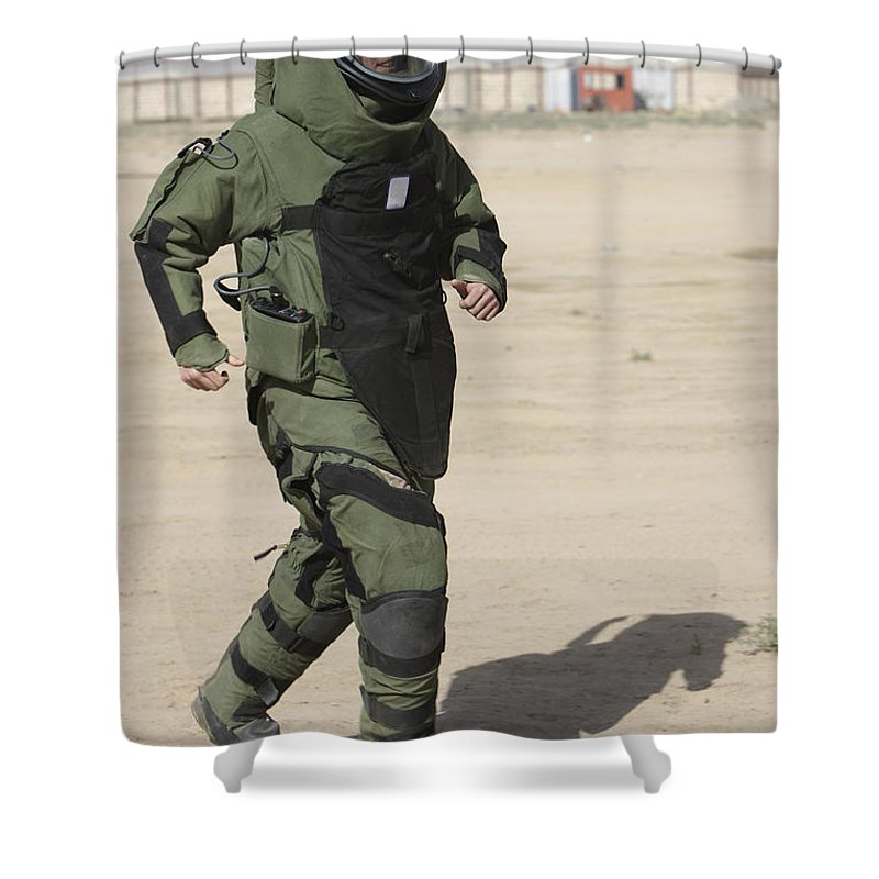 Soldier Shower Curtain featuring the photograph A U.s. Marine Tries Running In A Bomb by Terry Moore