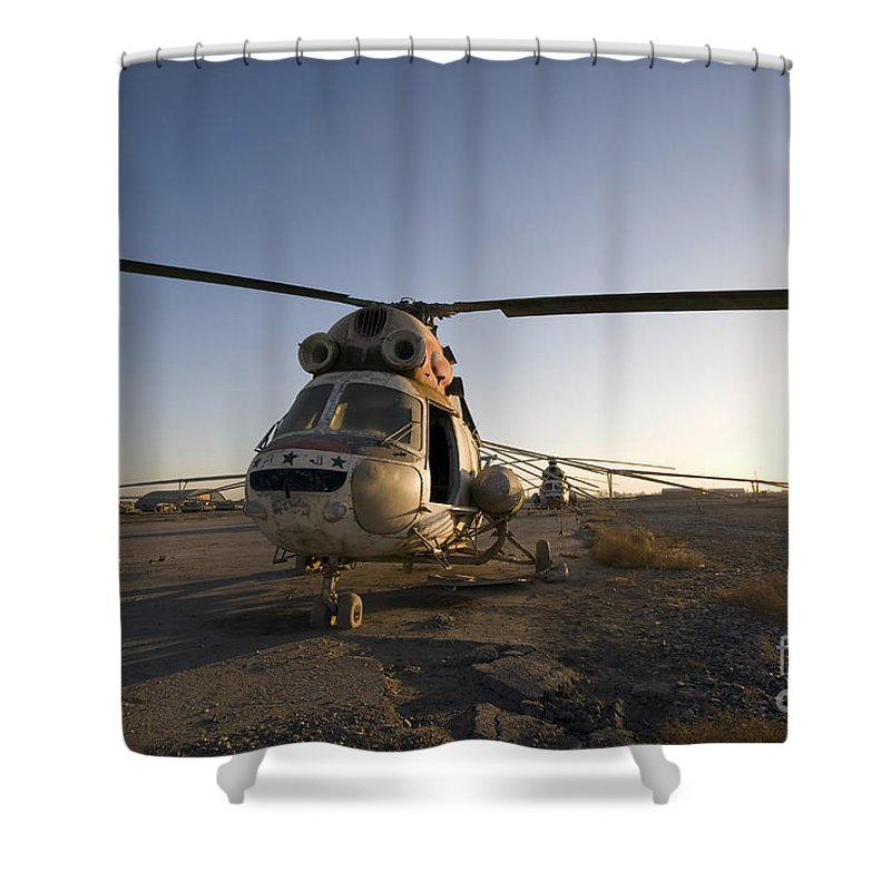 Aviation Shower Curtain featuring the photograph An Iraqi Helicopter Sits On The Flight by Terry Moore