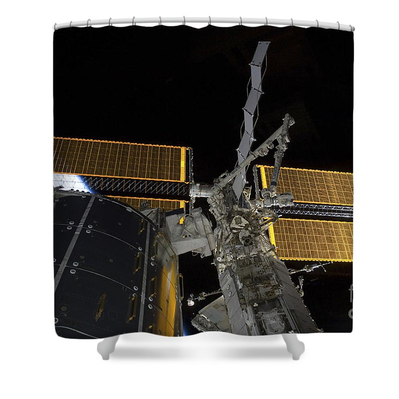 Technology Shower Curtain featuring the photograph The International Space Station by Stocktrek Images