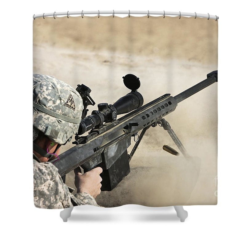Sniper Shower Curtain featuring the photograph U.s. Army Soldier Fires A Barrett M82a1 by Terry Moore