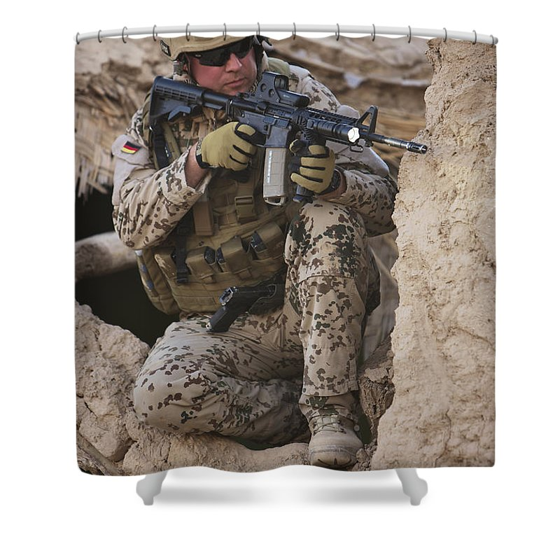 Sitting Shower Curtain featuring the photograph A German Army Soldier Armed With A M4 by Terry Moore