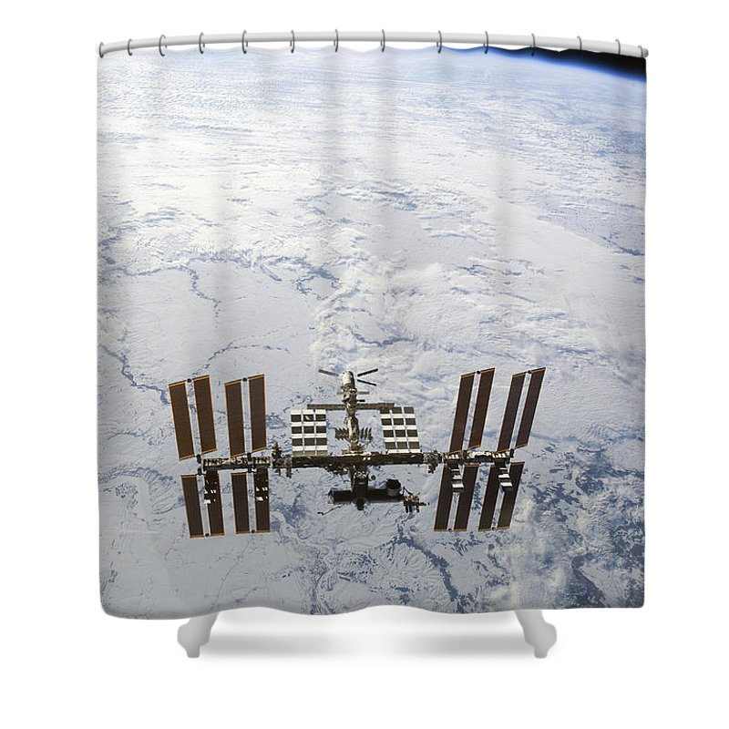 View From Space Shower Curtain featuring the photograph The International Space Station by Stocktrek Images