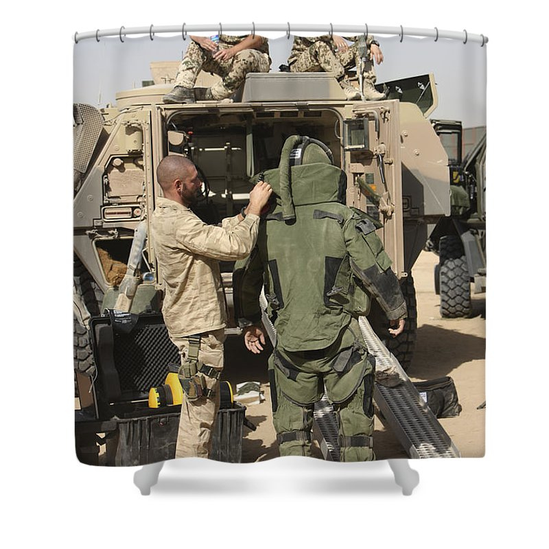 Afghanistan Shower Curtain featuring the photograph A U.s. Marine Gets Suited by Terry Moore