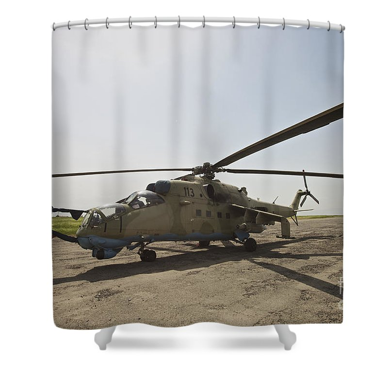 Kunduz Shower Curtain featuring the photograph An Mi-35 Attack Helicopter At Kunduz by Terry Moore