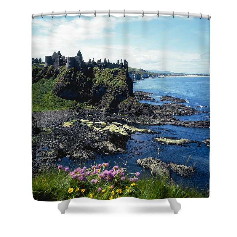 Archeological Site Shower Curtain featuring the photograph Dunluce Castle, Co Antrim, Ireland by The Irish Image Collection