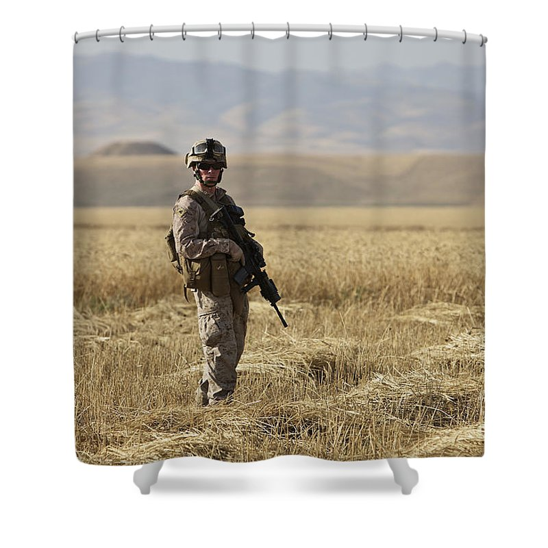 Patrol Shower Curtain featuring the photograph U.s. Marine Patrols A Wadi Near Kunduz by Terry Moore
