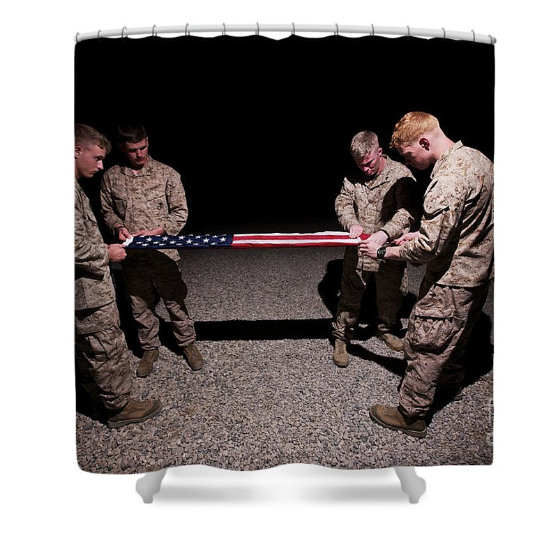 Night Shower Curtain featuring the photograph U.s. Marines Fold The American Flag by Terry Moore