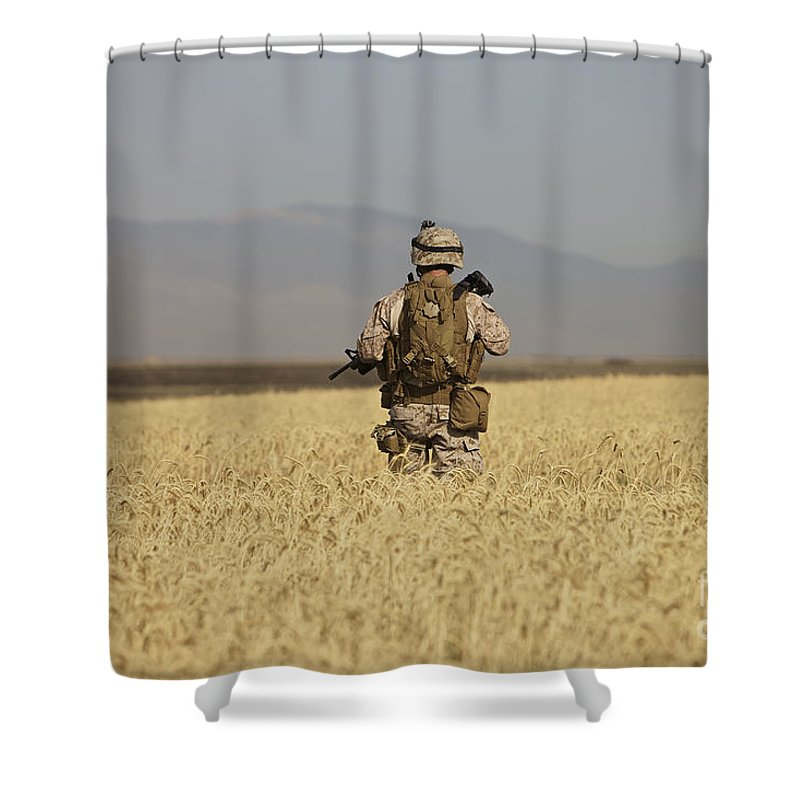 Wheat Shower Curtain featuring the photograph U.s. Marine Patrols A Wadi Near Kunduz by Terry Moore
