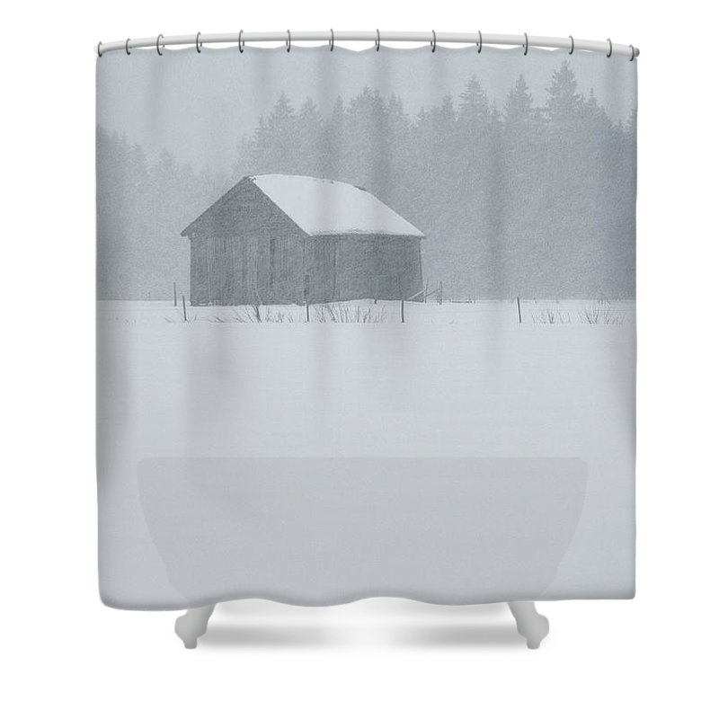 Natural Forces And Phenomena Shower Curtain featuring the photograph A Barn Behind A Fence In The Snow by Mattias Klum
