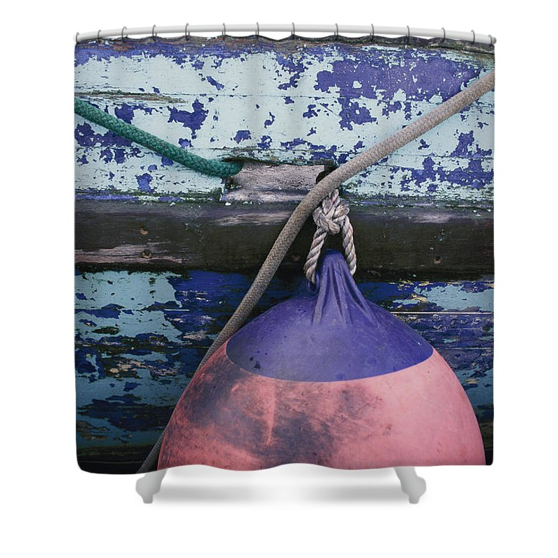 Kodiak Island Shower Curtain featuring the photograph A Colorful Buoy Hangs From Ropes by George F. Mobley
