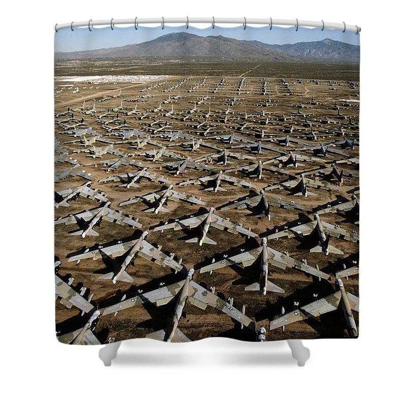 United States Shower Curtain featuring the photograph A Field Of Military Planes by Paul Chesley
