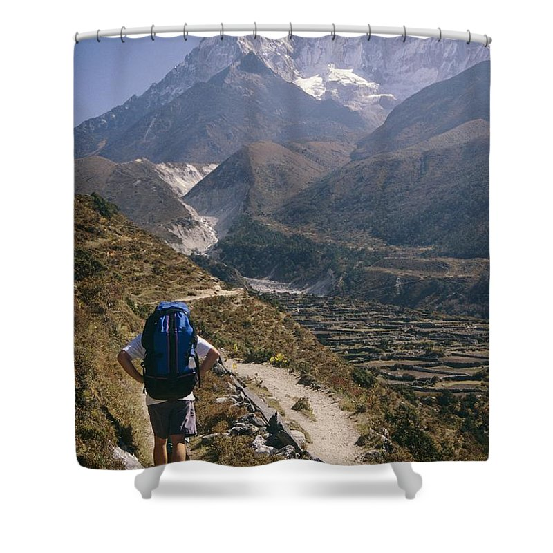 Shower Curtain featuring the photograph A Hiker With A Mountain Range by Michael Klesius