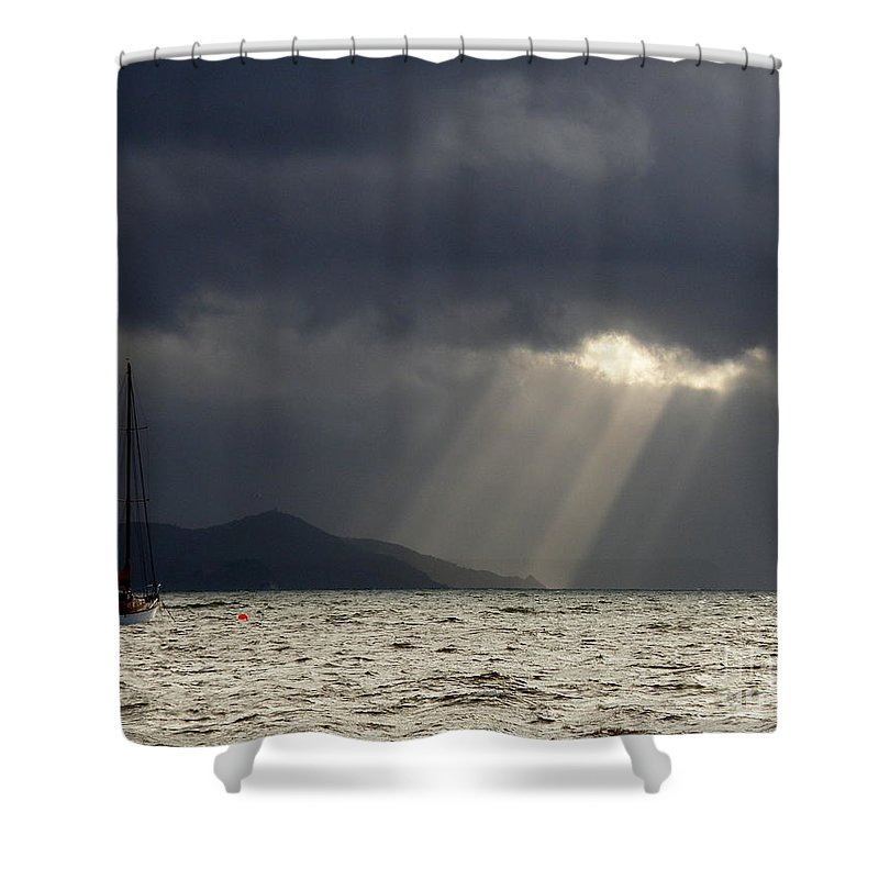 Seascape Shower Curtain featuring the photograph A Light In The Storm by Lainie Wrightson