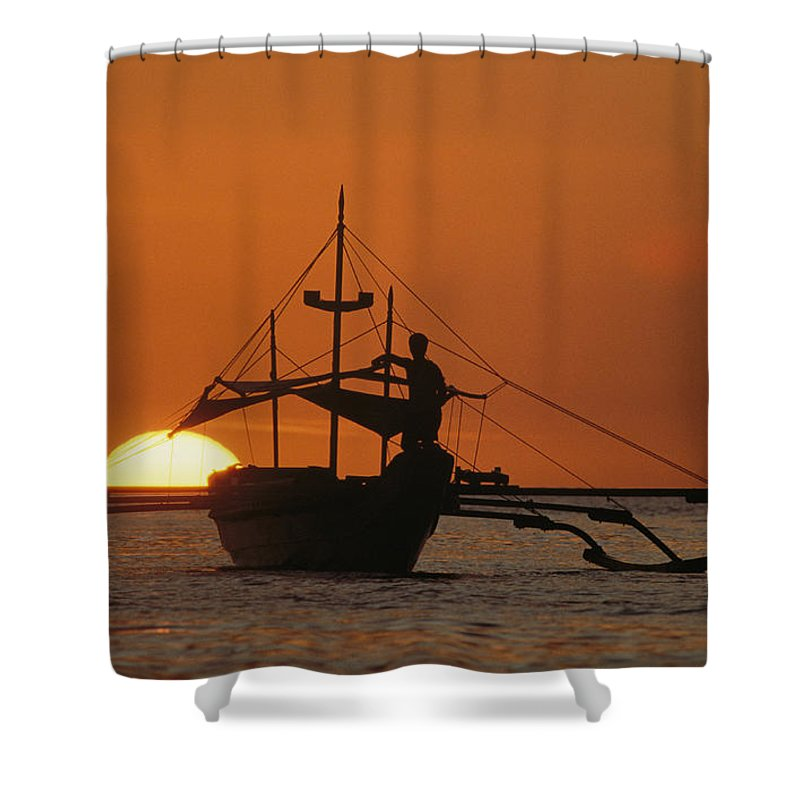 Pacific Islands Shower Curtain featuring the photograph A Man And An Outrigger Silhouetted by Paul Chesley