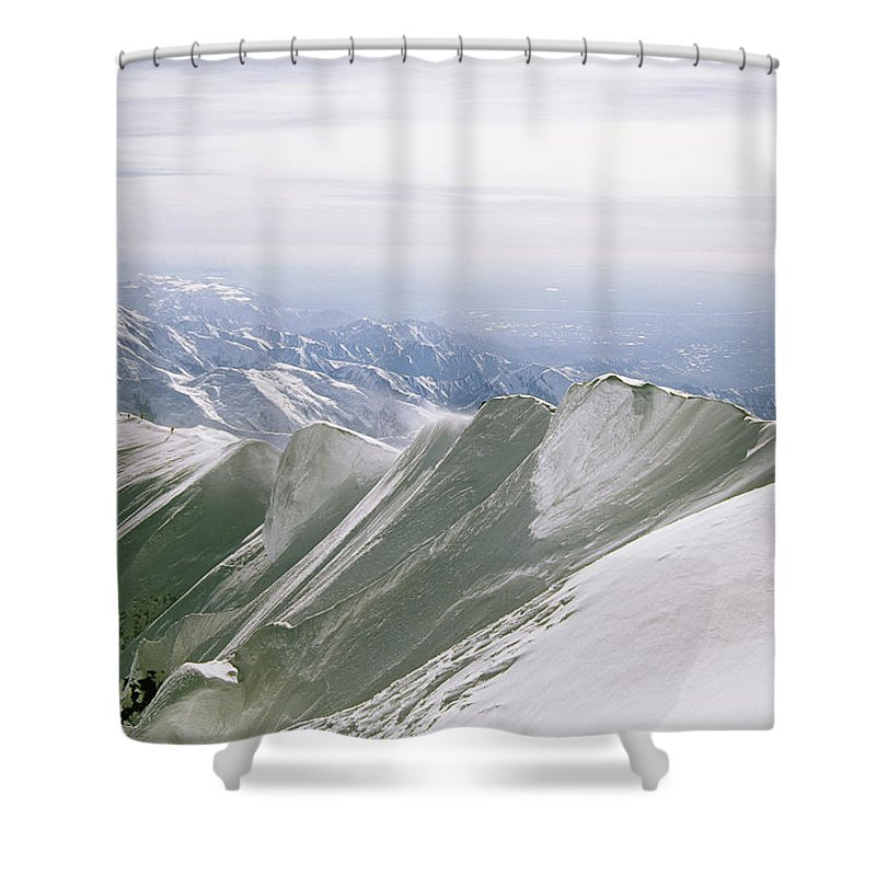 North America Shower Curtain featuring the photograph A Mountain Climber Hikes by Bill Hatcher