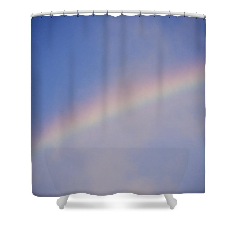 Natural Forces And Phenomena Shower Curtain featuring the photograph A Rainbow Arcs Across The Sky by Joel Sartore