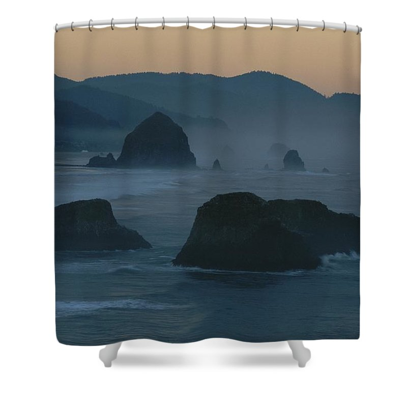 Geography Shower Curtain featuring the photograph A Rocky Shoreline Is Silhouetted by Chris Johns